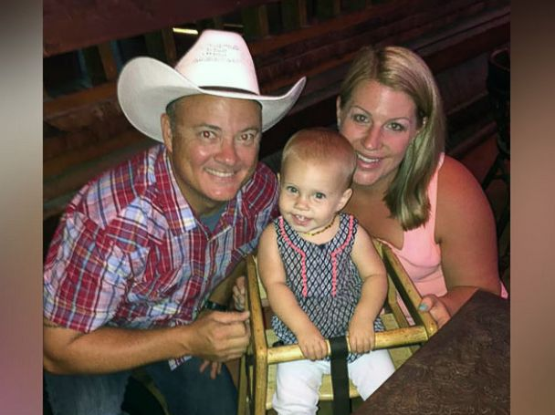 PHOTO: Courtney Hill photographed with her husband Brian and daughter, Reagan, 1 year old.