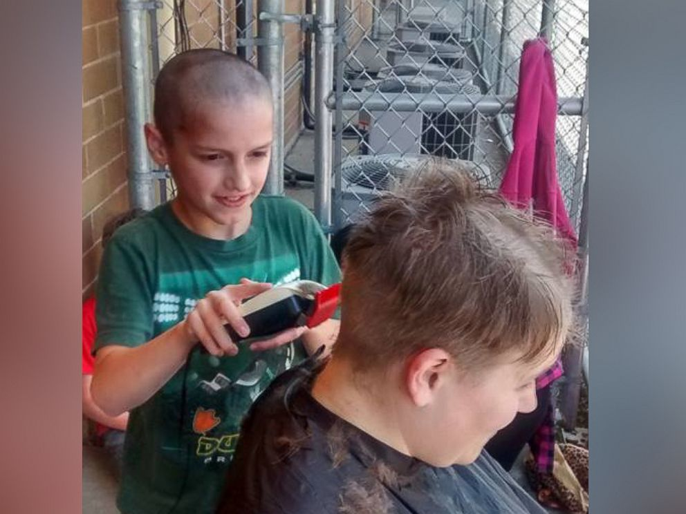 PHOTO: Tori Nelson allowed her fourth grade student to shave her head after he was bullied for his haircut.