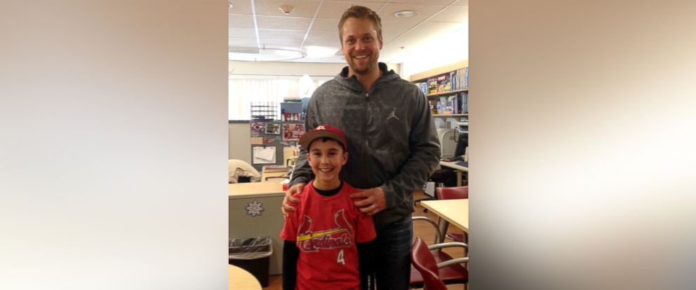 PHOTO: Ethan Cortez, 10, was surprised by St. Louis Cardinals pitcher Trevor Rosenthal at St. Louis Childrens Hospital on Jan. 13, 2015, after being treated for a dog bite.