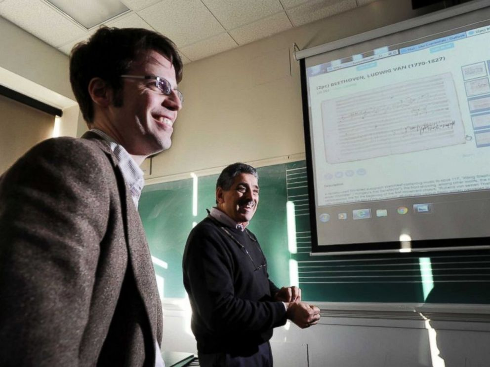 PHOTO: Manhattanville College Music Professor Carmelo Comberiati, right, and appraiser Brendan Ryan speak about a Beethoven score that belonged to a resident of Greenwich, Connecticut. Photo provided by greenwichtime.com.