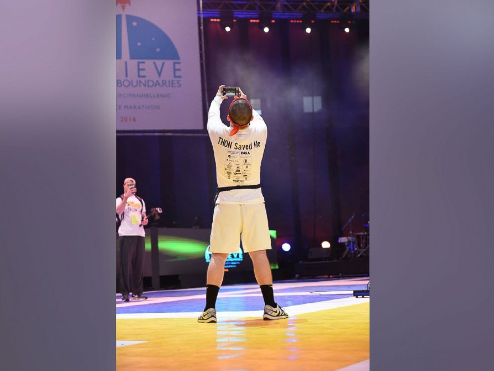 PHOTO: Brady Lucas snaps a photo at Penn State Universitys THON, which raises money for pediatric cancer patients.