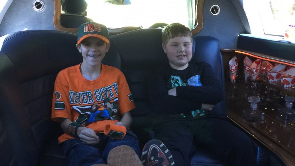 Colby pictured with his brother Colton, 8, on the way to WrestleMania.