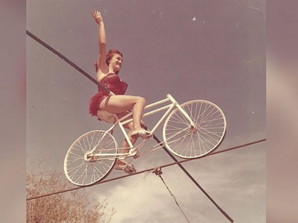 PHOTO: Carla seen bicycling on a tightrope.
