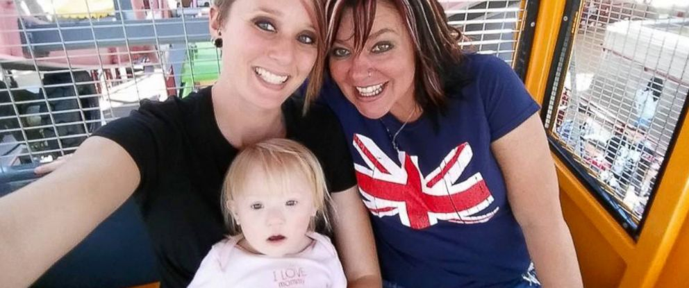 PHOTO: Andrea and Keston Ott-Dahl photographed with their daughter, Delaney 2.