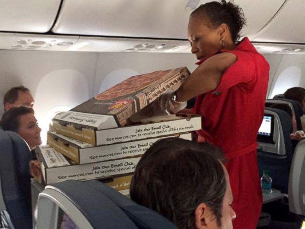 delta air lines pilot surprises plane with pizza party passenger says abc news. Black Bedroom Furniture Sets. Home Design Ideas