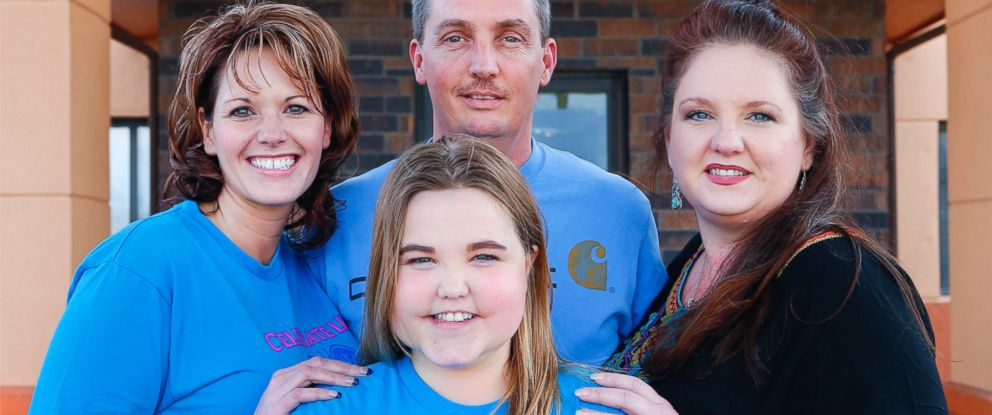 PHOTO: Three years after a double-lung transplant, Madison Taliaferro, center, can now breath easier thanks to Jason, back center, and Penny Lotts son Alex whose lungs were given to Madison after his unexpected death at age 17.
