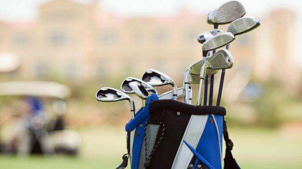 PHOTO: Golf clubs in a golf bag.