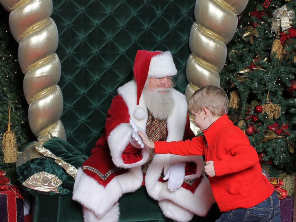 PHOTO: His mom said it took about 20 minutes, but Brayden finally warmed up to Santa.