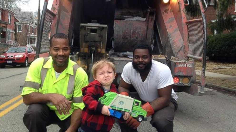 """Ollie Kroner posted this photo to Facebook, March 13, 2015, with the caption, """"Quincy's been waiting all week to show the garbage men his garbage truck. But, in the moment, he was overwhelmed in the presence of his heroes."""""""