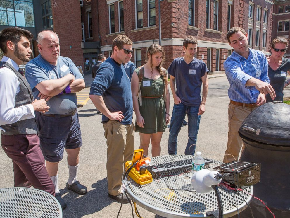 PHOTO: Students show off their custom meat smoker.