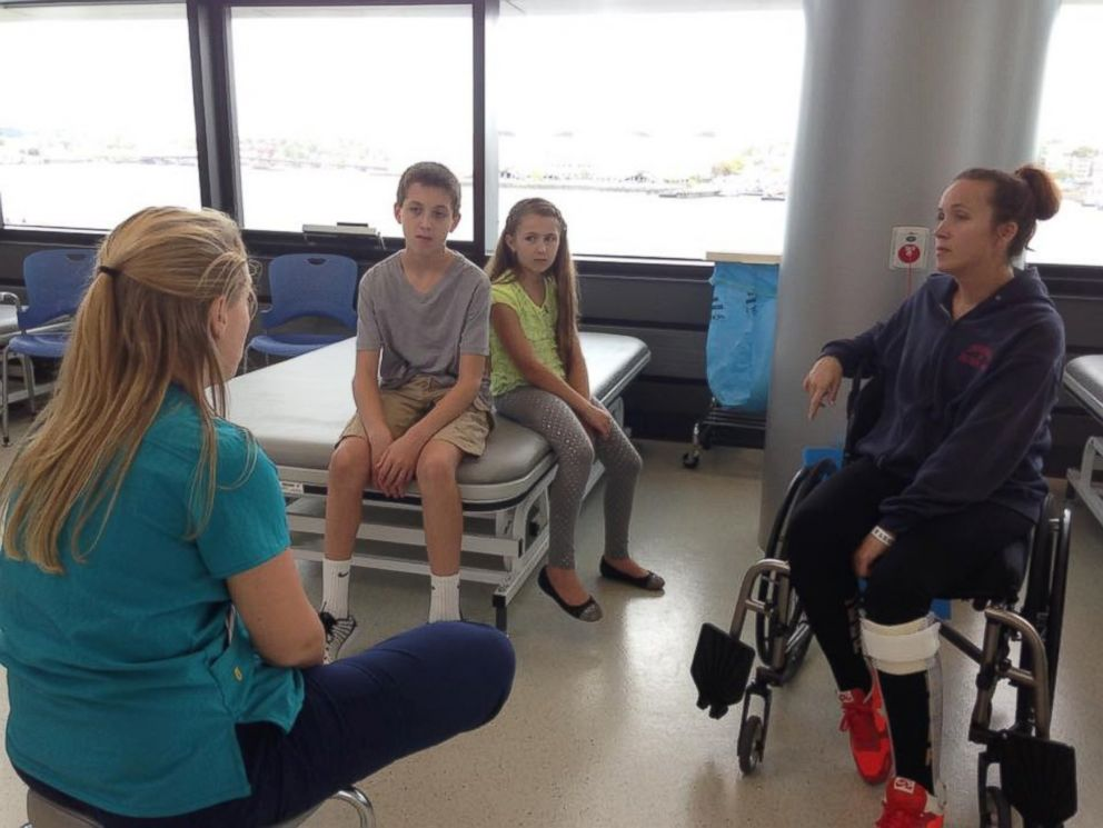 PHOTO: Carnucci with her children at the recovery center.