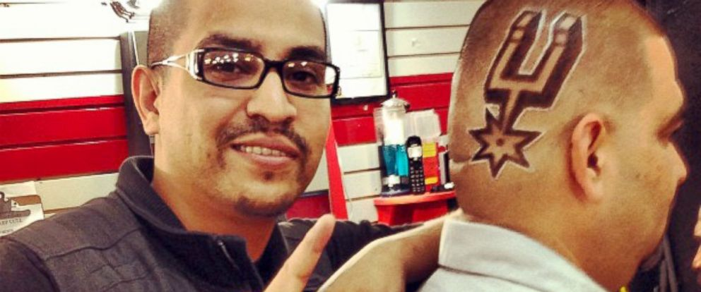 PHOTO: Joe Barajas, known as Joe the Barber, shows off one of his famous Spurs haircuts.