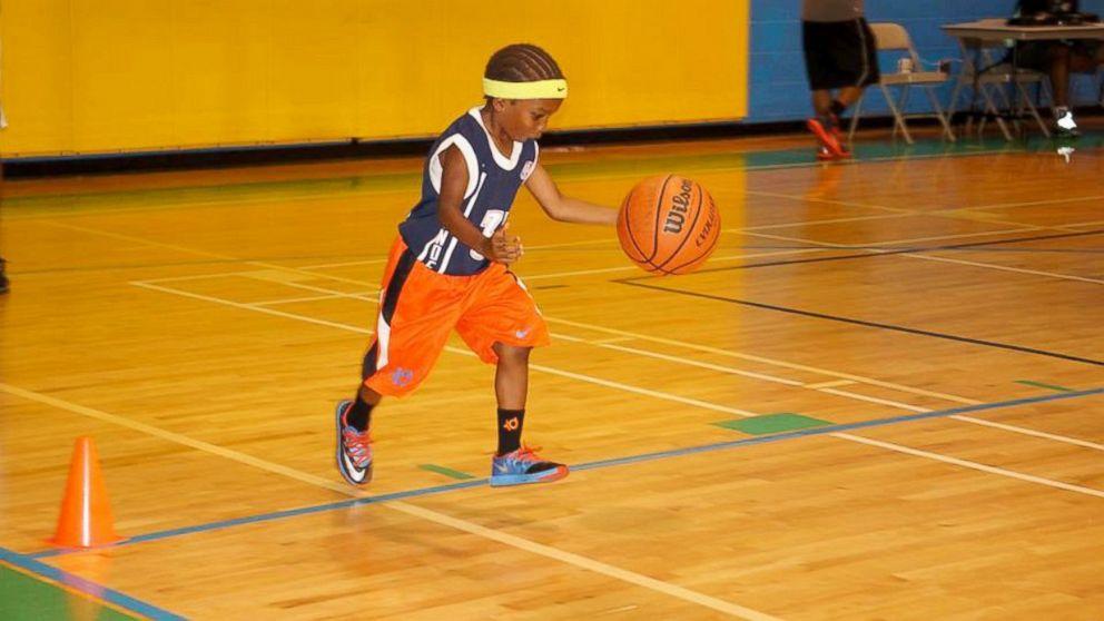 Black kid shooting basketball