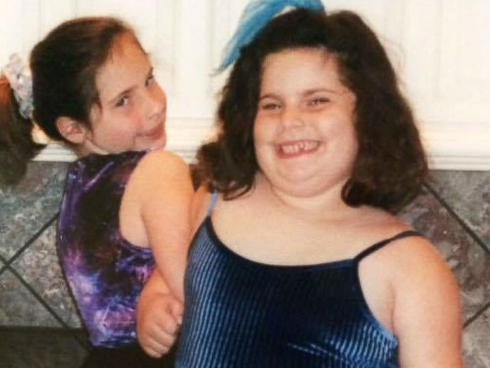 PHOTO: Lesley Miller, right, with her older sister Carly during their childhood, growing up in Dallas.