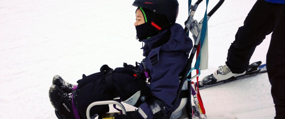 PHOTO: Maximus Wong, 7, has weakness in his legs brought on by spinal damage when he was younger, but he sped down the ski slopes in a sit-ski.