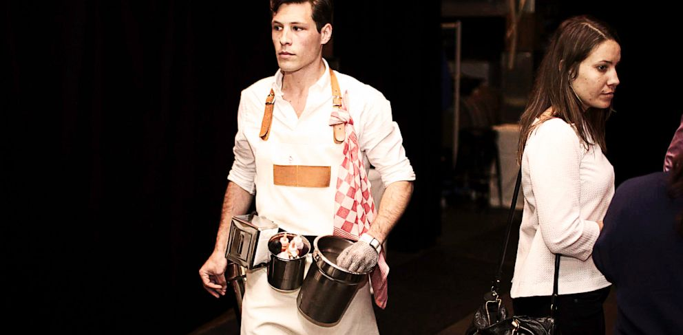 PHOTO: A waitstaff member of Oysters XO is armed with buckets for shucking oysters.