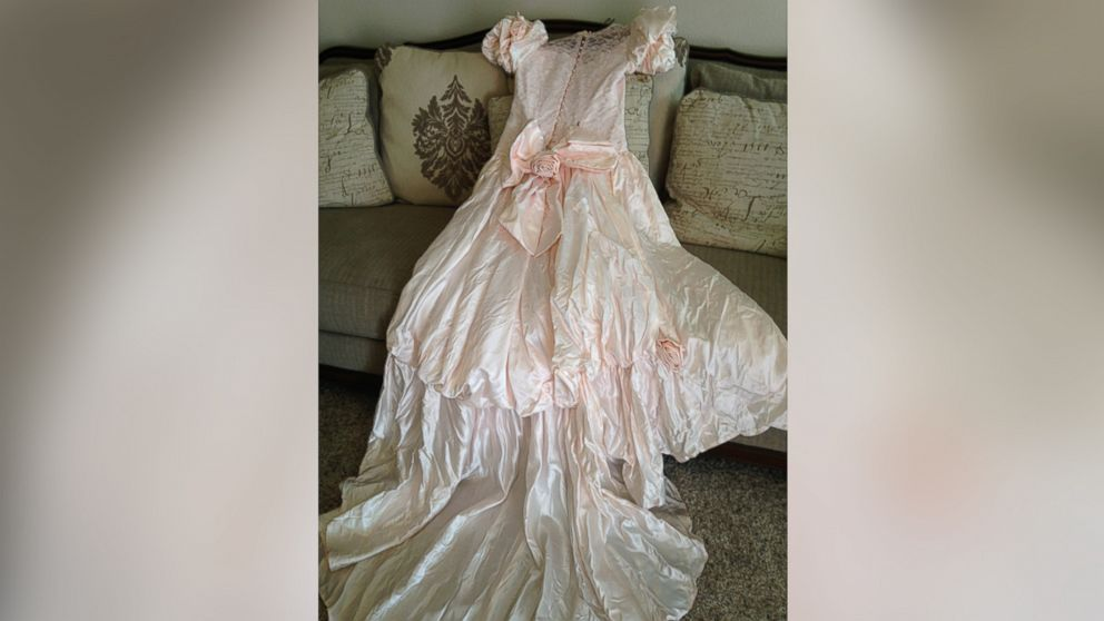 Texas woman, Barbara Haynes, is searching for the owner of this pink wedding gown she found after a tornado hit.