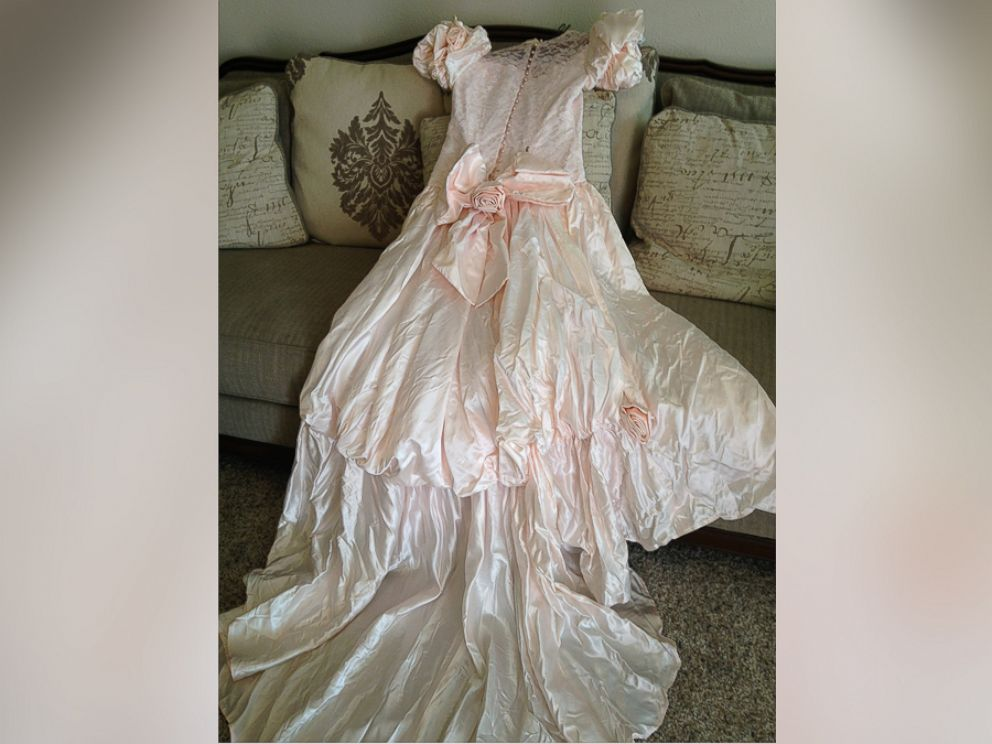 PHOTO: Texas woman, Barbara Haynes, is searching for the owner of this pink wedding gown she found after a tornado hit.
