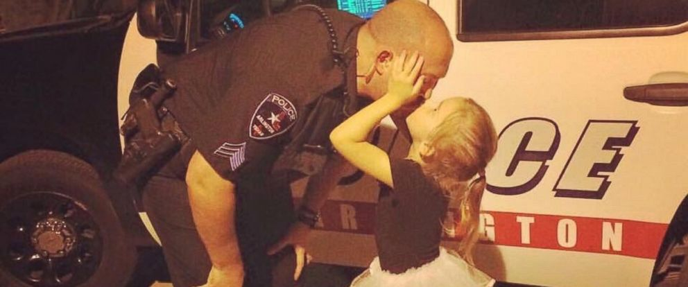 PHOTO:A photo of Sergeant J. McRay kissing his little girl has gone viral online.