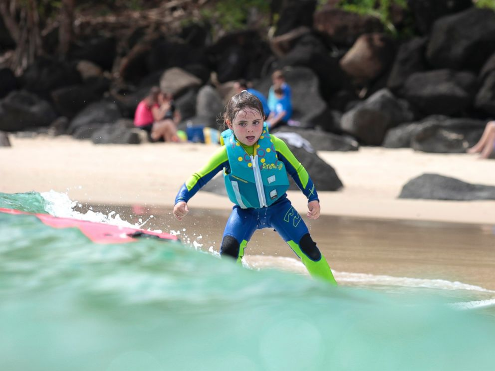 PHOTO: Quincy Symonds, 4, is pictured surfing at Snapper Rocks, Australia.