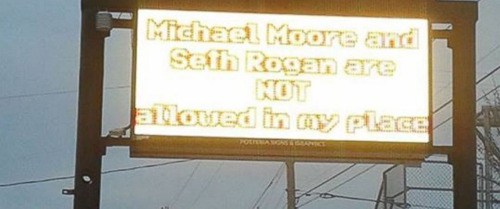"""PHOTO: A restaurant in Michigan has banned Michael Moore and Seth Rogen in response to remarks they made about """"American Sniper."""""""