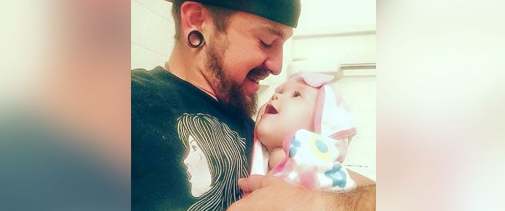 PHOTO:Johnson, 21, pictured with his daughter Persephone, 10 months old.
