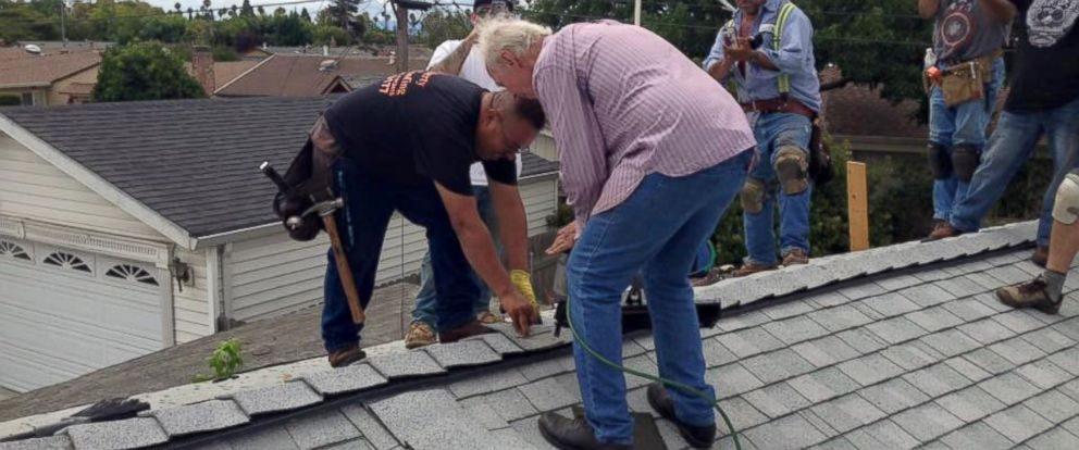 PHOTO: Richard Dubiel, 75, hammered in the final nail after strangers volunteered to repair his roof.