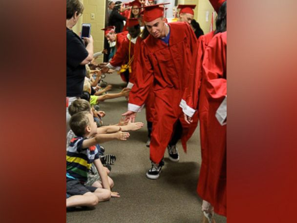PHOTO: Seniors at Van High School in Texas handed out high fives to elementary school students in now viral photos.
