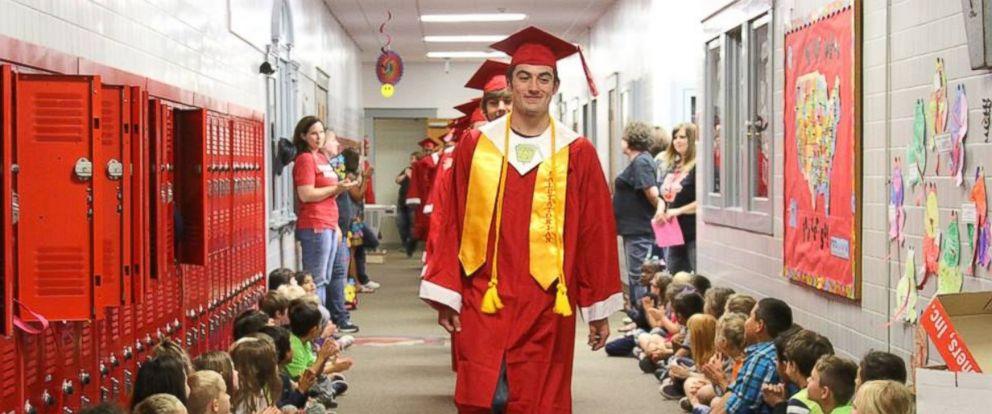 "PHOTO: Seniors at Van High School in Texas proudly walked the halls on the schools inaugural ""Senior Walk."""