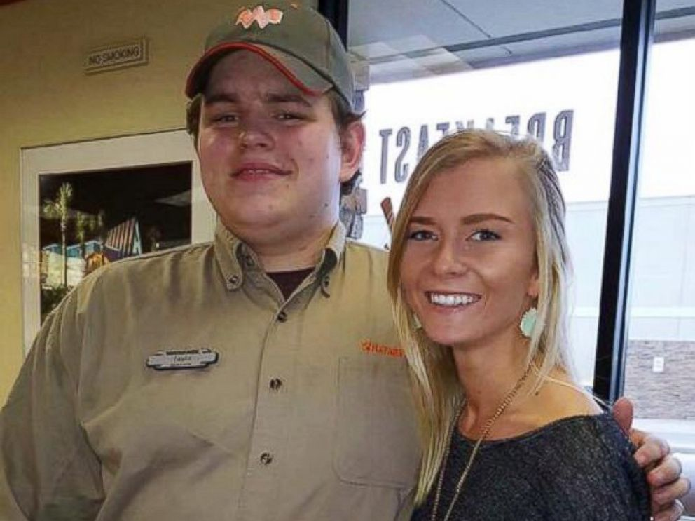 PHOTO: Taylor pictured with Kolbie Sanders, 21, who shared the photo on Facebook of customers kindly writing down their food orders, after learning he was deaf.