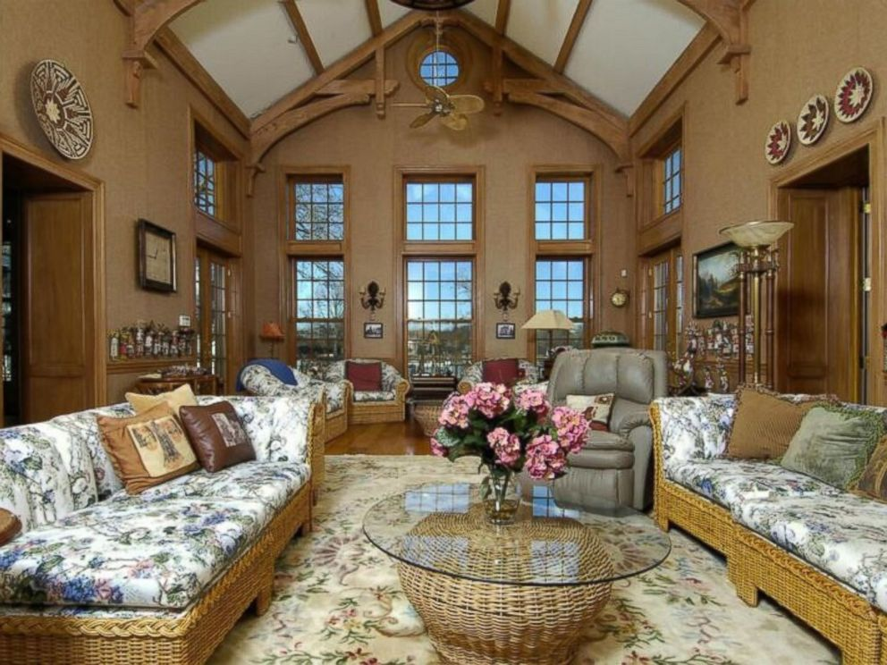PHOTO: Donald Trumps former Connecticut mansion features a massive living room with an arched-ceiling and wood details.