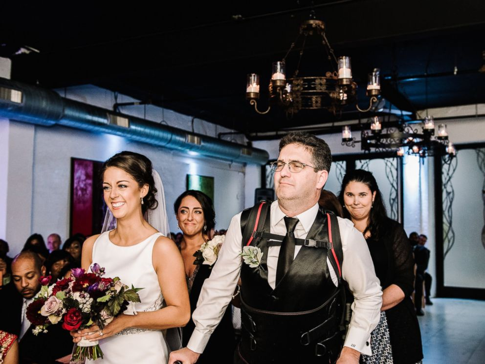 PHOTO: Scott Holland didnt let his multiple sclerosis stop him from walking his daughter, Elise Holland, down the aisle. He surprised her on her wedding day by using an exoskeleton to help him walk.