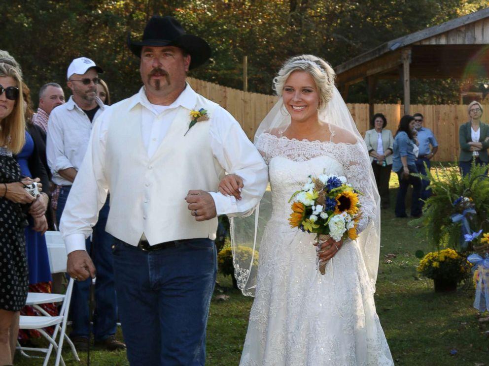 PHOTO: Mikayla Wroten walks down the aisle with her stepdad, Paul Williams.
