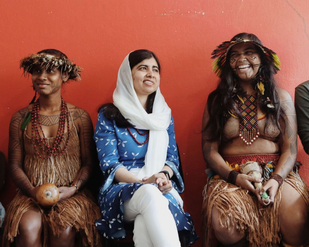 Malala with indigenous Brazilian girls in 2018.