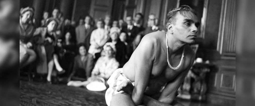 PHOTO: B.K.S. Iyengar gives a yoga demonstration to tennis players at a pre-Wimbledon party in a London suburb in June, 1960.