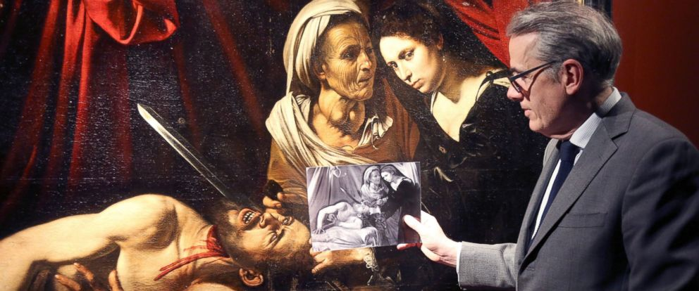 """PHOTO: French art expert Stephane Pinta shows an x-ray image of a painting entitled """"Judith Beheading Holofernes"""" during its presentation in Paris, April 12, 2016"""