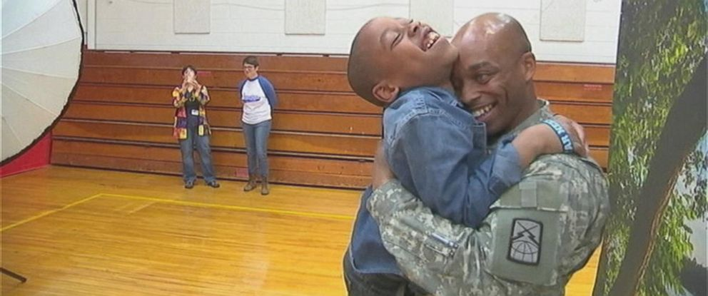 PHOTO: Corporal James Bass returns home and takes the opportunity to surprise his unsuspecting son.