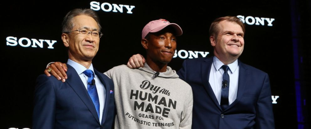Sony President and CEO Kenichiro Yoshida, left, musician Pharrell Williams, middle, and Sony Music Entertainment CEO Rob Stringer, right, pose for a photograph at the Sony news conference at CES International, Monday, Jan. 7, 2019, in Las Vegas. (AP