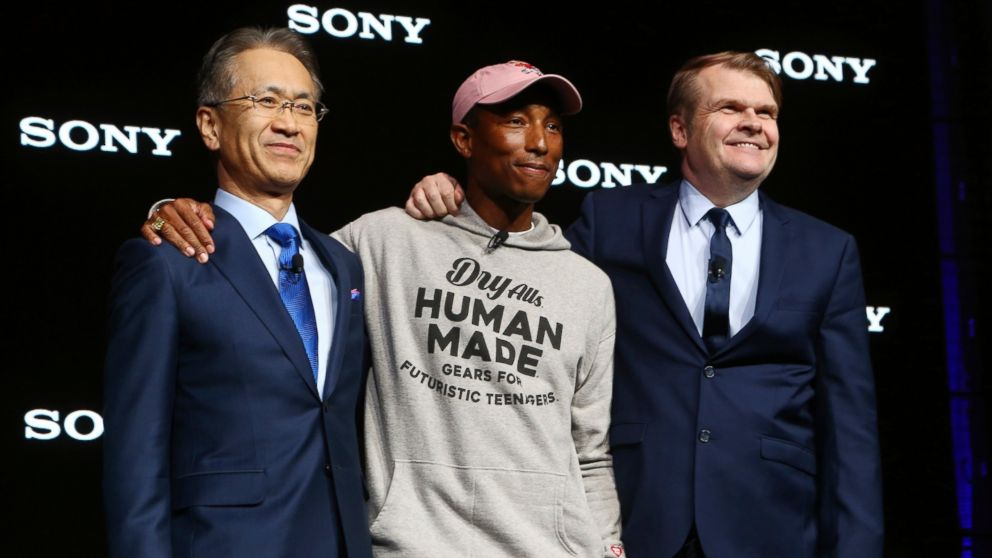 Sony President and CEO Kenichiro Yoshida, left, musician Pharrell Williams, middle, and Sony Music Entertainment CEO Rob Stringer, right, pose for a photograph at the Sony news conference at CES International, Monday, Jan. 7, 2019, in Las Vegas. (AP Photo/Ross D. Franklin)