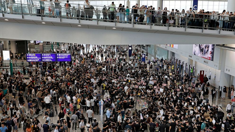 Hong Kong protesters take their cause to airport arrivals thumbnail
