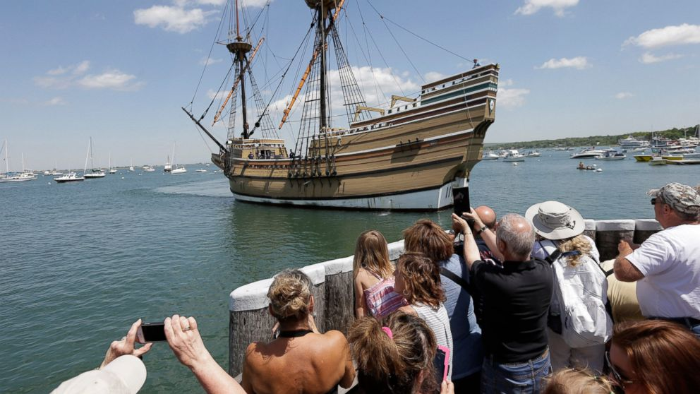 FILE - In this June 6, 2016 file photo, people on a wharf watch as the Mayflower II, the 1957 replica of the famed ship that carried the Pilgrims to Massachusetts in 1620, arrives in Plymouth Harbor in Plymouth, Mass. Organizers gathered Thursday, March 14, 2019, at the New England Historical Genealogical Society to sketch out plans for a yearlong remembrance in 2020 of the ship's voyage. Events also are planned in Britain and in the Netherlands, where the Pilgrims spent more than a decade before sailing to the New World. (AP Photo/Steven Senne, File)