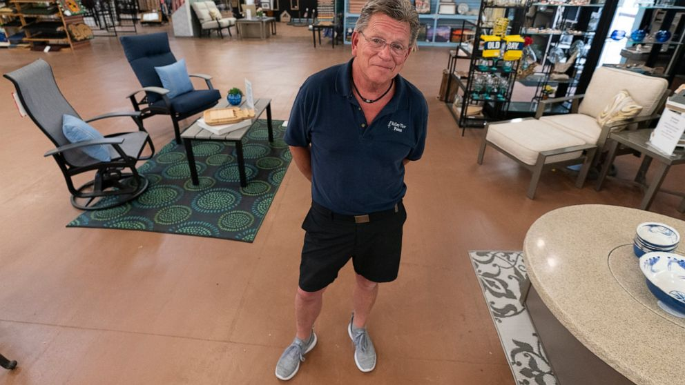 In this July 6, 2021, photo John Hessler, 62, the patio section manager at Valley View Farms in ****eysville, Md., poses for The Associated Press in his showroom. (AP Photo/Julio Cortez)