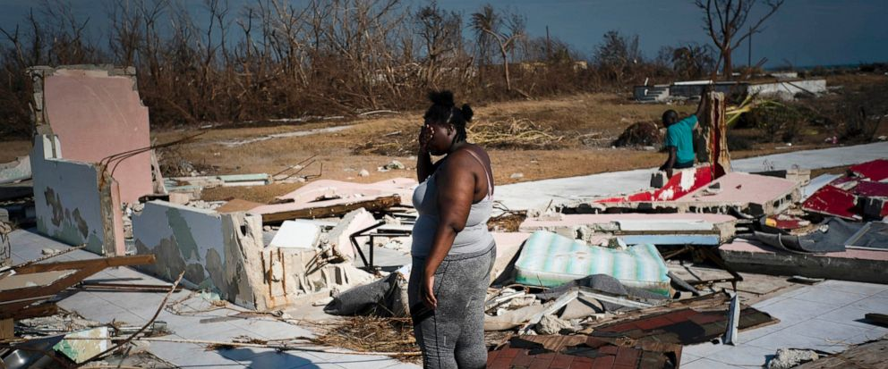 A woman is overcome as she looks at her house destroyed by Hurricane Dorian, in High Rock, Grand Bahama, Bahamas, Friday Sept. 6, 2019. The Bahamian health ministry said helicopters and boats are on the way to help people in affected areas, though of