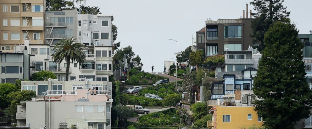 FILE - In this April 15, 2019, file photo, cars wind their way down Lombard Street in San Francisco. Thousands of tourists could soon be forced to make reservations and pay to drive the famed crooked Lombard Street in San Francisco. California lawmak