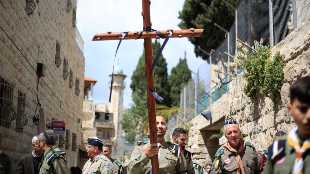 Christian pilgrims march through Jerusalem for Good Friday