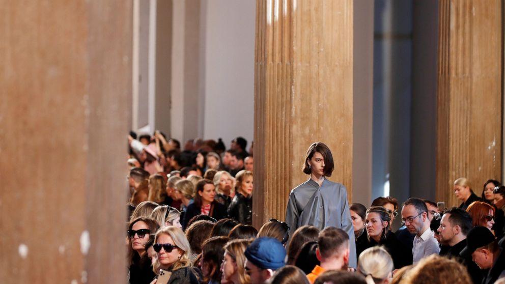 Milan Fashion Week carries on amid virus, economic...