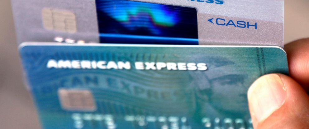 FILE - In this July 18, 2016, file photo, American Express credit cards are photographed in North Andover, Mass. American Express is buying the online reservation startup Resy, the companies announced Wednesday, May 15, 2019, the latest move by AmEx