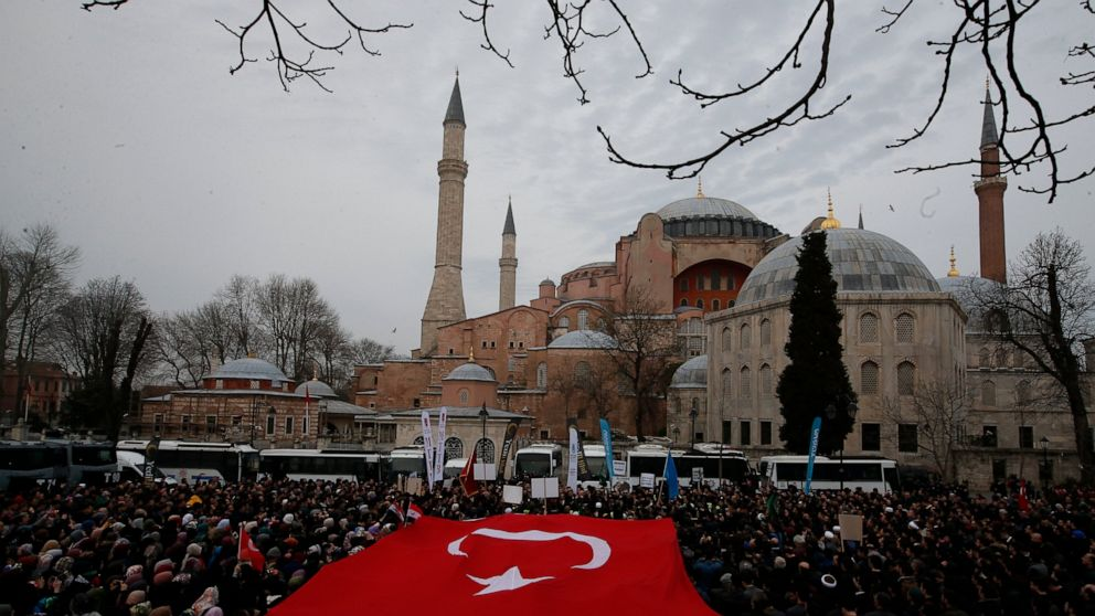 Backdropped by Hagia Sophia, a Byzantine-era cathedral that was turned into a mosque and now serves as a museum, demonstrators protest against the mosque attacks in New Zealand, in Istanbul, Saturday, March 16, 2019. Thousands of demonstrators have protested the New Zealand mosque shootings outside Istanbul's Hagia Sophia - a Byzantine-era cathedral that was turned into a mosque and now serves as a museum. The demonstrators - mostly members of Islamic-leaning civil society groups - called for the symbolic edifice to be reconverted into a mosque.(AP Photo/Lefteris Pitarakis)