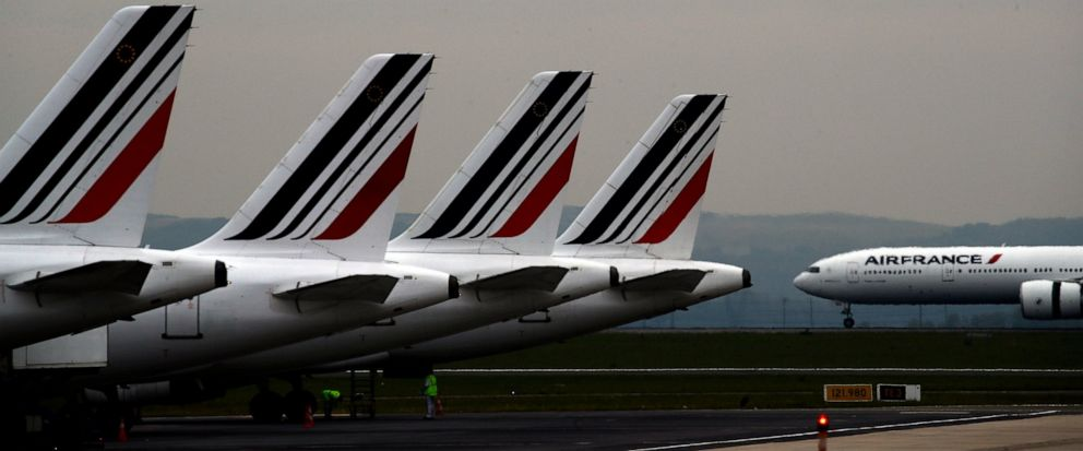 """FILE - In this May 17, 2019 file photo, Air France planes are parked on the tarmac at Paris Charles de Gaulle airport, in Roissy, near Paris. The French government will implement an """"ecotax"""" on plane tickets for flights departing from France from nex"""