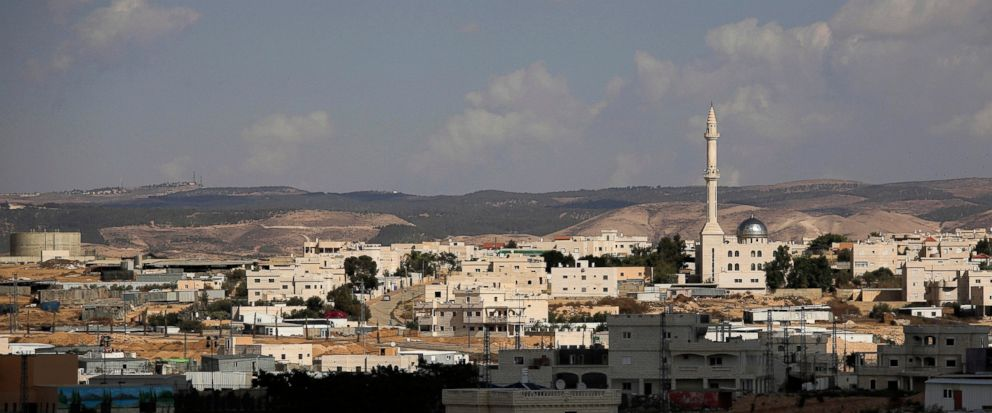 FILE - This Oct. 20, 2014 file photo, shows a view of Hura, a predominantly Bedouin town in the Israeli Negev desert. Israel has begun cracking down on polygamy among the country's Bedouins, after decades of turning a blind eye to the old custom that